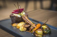 Grilled Tenderloin - Roasted potatoes, root vegetables and compounded butter