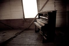 Old abandoned piano in abandoned church