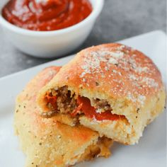 These Keto Fathead Pizza Pockets are delicious proof that going low carb does not mean giving up your favorite foods!