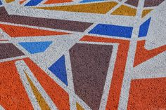 A close up of a geometric ground mural featuring sharp angles and eccentric colors at the Storey Park Junction Paint Jam on June 6th, 2015 in the NoMa neighborhood in Washington, DC. || #AlexTonettiPhotography #Photography