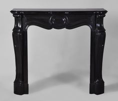 Small #antique #Pompadour #fireplace #mantel in Black from Belgium #marble, #19thcentury  #frenchantiques #interiordecoration #black #decor #design #louis15 #french #style Available on #MarcMaison website