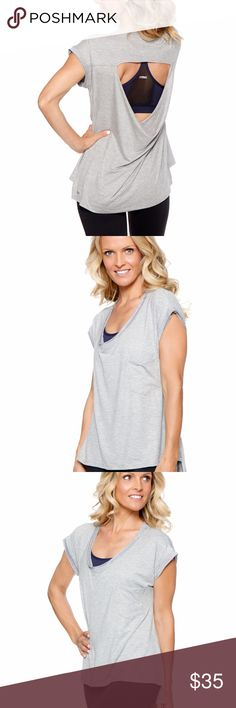 Courtney top in grey Courtney is a new lifestyle tee with a beautiful feminine drapey open back detail. This is a great top to wear to class and then out for the day. We love this top so much we have made it in two fabrics. Our signature rayon blend fabric and a new fabulous lightweight cotton slub in anthracite and navy. This is one you will want to buy in both fabrics and all colors! Item is a sample guaranteed new and unworn but may or may not have original packaging or tags. Rese…
