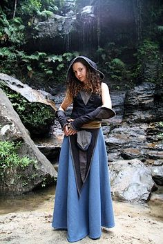 Blue skirt, hooded tunic, and gauntlets. ~ I'd also give her a long sleeved shirt to cover her arms