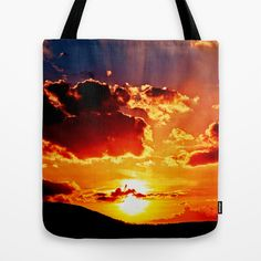 Cloudy colored sundown   Tote Bag by Pirmin Nohr - $22.00 Wonderful sunset on a cloudy day in summer  Landscape, sun, sunrays, sunbeams, silhouettes, gaudy, colorful, mountain