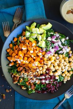 This Chopped Kale Power Salad with Lemon Tahini Dressing is the perfect salad to start the New Year with!  Eat it for lunch and you'll have energy all day!  Packed with healthy and delicious ingredients, including: sweet potato, chickpeas, almonds, avocado, cranberries and red onion! #ad