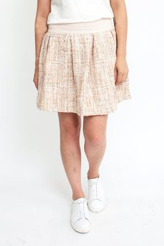 Opt for a pretty and preppy look with this sophisticated skirt. The feminine…