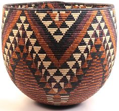 Africa | Zulu 'Iqoma' Bowl from South Africa |   To create this traditional basket, weavers use strips of naturally waxy palm fronds wrapped around coils of wild grasses