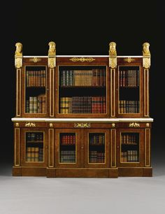 Royal Regency ormolu-mounted burr-yew breakfront bookcaseSupplied to George, Prince of Wales for Carlton House, London, by Marsh and Tatham in 1806, probably to a design by Charles Heathcote Tatham