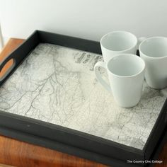 Transform a simple serving tray into a serious statement piece by simply decoupaging a vintage map to the bottom.