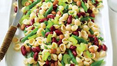 We combined two potluck classics—pasta salad and three-bean salad—to make one tasty new side dish. Blanched celery is the unexpected star in this side