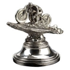 'Motorcycle' car mascot.   From a unique collection of antique and modern decorative objects at http://www.1stdibs.com/furniture/more-furniture-collectibles/decorative-objects/