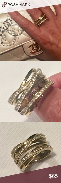 Auth Michael Kors stacked Gold Crystal ring sz 7 Authentic Michael Kors stacked ring! Beautiful design w/stacked rings intertwining! All crystals intact. Some scratches/wear as shown in pics. Hardware / crystals are still very bright 🌟💍 You will definitely get compliments when you wear it! ☑️Please note, I only go thru Poshmark for transactions👍🏽. 🚫trades as I'm trying to fund my next 👛😍. Thanks for checking out my closet! 👠👛 Michael Kors Jewelry Rings
