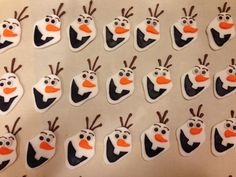 Olaf cupcake toppers from Disney's Frozen. Fondant with candy melt accents.