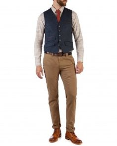 A handsome herringbone waistcoat completes a retro 40's look for men from Ted Baker