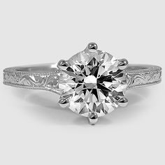 ADVICE: WHEN BUYING A ROUND DIAMOND ITS BETTER TO HAVE A 6 PRONG SETTING THAN 4 SO YOU WILL NOT LOSE YOUR DIAMOND IF A PRONG LOOSENS OR BREAKS.