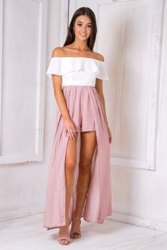 """The """"Tully maxi playsuit - White/Pink"""" is a perfect way to mix up your wardrobe this summer! Featuring an off the shoulder frill neckline, contrasting fabrics, playsuit length shorts with a maxi skirt overlay. Style it with nude lace up heels and a peach toned lipstick! Size 8, Length:134cm/56inches Width:32cm/13inches Polyester Cold Hand Wash Only Model wears a size 8 Model's height 172cm Prints may vary Imported A slight variation may occur in colours and size specifications. Colours ma..."""