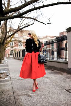 Atlantic-Pacific: military/dompteur style Ralph Lauren jacket, red midi skirt, red pumps/heels, Chanel jumbo flapbag