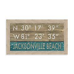 Framed nautical theme Giclée beach sign features the coordinates of Jacksonville Beach, FL. Jacksonville Beach appears at the bottom in the negative space of a blue painted panel while its longitude and latitude are printed in white at the top.