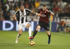 Stefano Sturaro of Juventus FC in action against Juraj Kucka of AC Milan during the Supercoppa TIM Doha 2016 match between Juventus FC and AC Milan at the Jassim Bin Hamad Stadium on December 23, 2016 in Doha, Qatar.