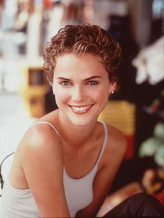 The 38 Most Iconic Pixie Cuts of All Time: KERI RUSSELL: In Felicity, 1999. Keri keeps her curly cut short and sweet.