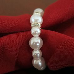 Wedding Table Decor - White Pearl Napkin Rings with Bling . Get your faux pearls at www.fizzypops.com ...we have a huge selection and offer bulk discounts