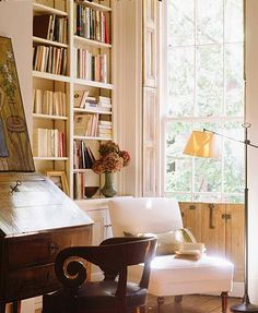everything I love in one place - books, natural light, a comfortable chair & a place to write