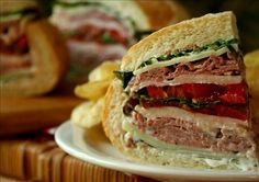 Tailgate Club Sandwich from Food.com:   								Easy to make up and take to the football tailgate party. Add cold beer and Maui chips and you may miss the kickoff. Enjoy!