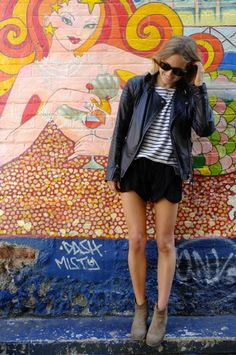 Beige ankle booties, scalloped black skirt, black and white striped shirt, black leather jacket