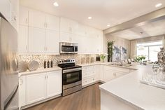 Love the white cabinets, grey counters and the floor New Home Designs, White Cabinets, Mosaic Tiles, Things To Buy, Home Kitchens, New Homes, Shabby Chic, House Design, Flooring