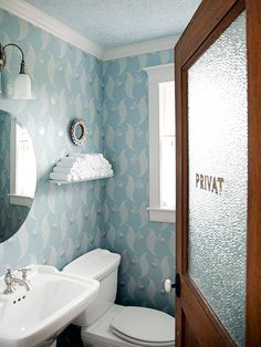 Add a frosted view for bathroom privacy: Make doors with glass panels work for a half bath by applying frosted film