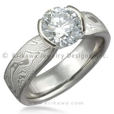 Mokume Solitaire Tapered Engagement Ring - This simple yet enchanting ring has a classic design with a contemporary twist. The band has a uniform width until it intersects the head with an elegant taper. The setting tapers down to the band allowing for the unique engagement ring to sit flush next to a flat wedding band.