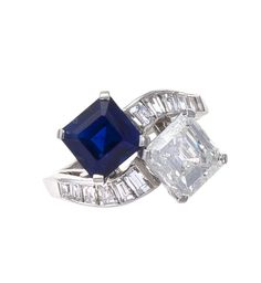 A sapphire and diamond ring, Van Cleef & Arpels  of crossover design, the square-cut sapphire weighing 2.92 carats, and the modified square-cut diamond weighing 2.38 carats, completed by baguette-cut diamond scrolling shoulders and a plain mount; signed VCA for Van Cleef & Arpels, no. 36748; remaining diamonds weighing approximately: 0.70 carats total; mounted in platinum