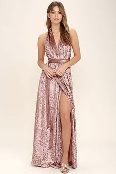 Once the Aphrodite's Kiss Blush Velvet Halter Maxi Dress comes along, love and romance will follow! Luxurious crushed velvet falls from an elasticized halter neckline, into a wrapping bodice that carries into a cascading maxi skirt. Open back and tying sash belt.