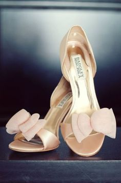 a03e782b451a Blushing pretty with these darling satin peep toe pumps and layered tulle  bow from Badgley Mischka. Image via Style Me Pretty.