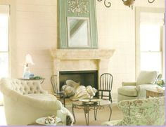 Love the mirror and chevkout the #shells in the fireplace,