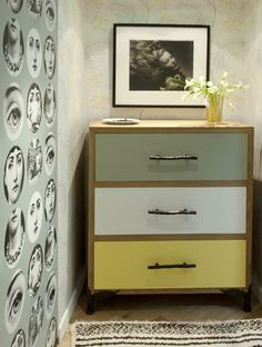 In the dressing room, Haenisch juxtaposes Fornasetti   and floral wallpapers   by Cole & Son
