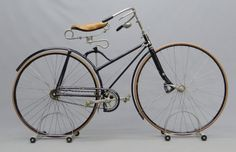 Lot Image. Columbia Camelback hard tire safety bicycle, serial #8521, 1890, sprung front suspension, restored, rideable with bell. Pedaling History Museum Collection.