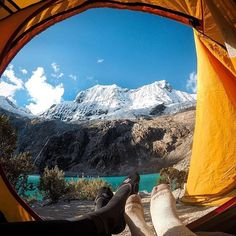 Photo of the Day: After venturing 4600m into the raw #landscape of Huaraz, #Peru, @geo_wood kicked off his boots and relaxed before the glacial views of #Laguna69.  Share your #camping shots with us at gopro.com/awards. • • • #GoPro #GetOutside #Camp #GoProTravel #WinterCamping