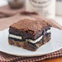"With a name like ""slutty brownies"" you know these bars have to be outrageous- chocolate chip cookie dough, Oreos, and brownie!"