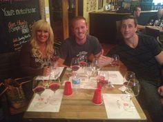 Carolyn, Josh, & Will enjoying their wine tasting