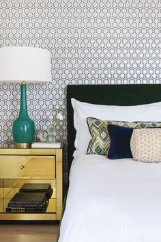Cole & Son's Hicks Hexagon wallpaper from Kravet enlivens the master bedroom. A Golinda mirrored chest from Horchow flanks the Wyatt bed from Room & Board. The Robert Abbey Lighting lamp is from Lumens Light + Living.