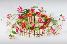 Colorful wreath with gloriosa, orange roses and Moby dicks ~ Andreas Verheijen » education