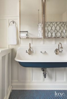 An existing clawfoot tub inspired the design of the children's bathroom on the third floor. The wife fell in love with the penny tile from Waterworks and sourced the Brockway trough sink by Kohler. Childrens Bathroom, Bathroom Kids, Small Bathroom, Kids Bath, Bathroom Black, Blue Penny Tile, Penny Tile Floors, Trough Sink Bathroom, Bathroom Floor Tiles