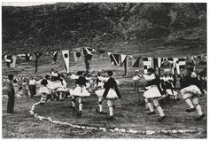 [Male folk dancers dancing outiside below a line of flags, Delphi, Greece] Copyright © David Seymour/Magnum Photos International Center of Photography Greek Music, Magnum Photos, People Art, Photomontage, Cool Eyes, Vintage Photography, 17th Century, Black And White Photography, Storytelling