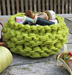 Free Knitting Pattern for Chunky Basket - Knit with 4 strands of bulky yarn held together this is a fast stash-busting project. 18 cm/ 7″ diameter across the base. Designed by Bonny Bonafilla