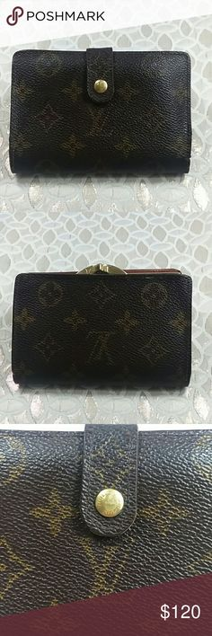 Authentic Louis Vuitton Kiss Lock Monogram Wallet Leather showed wearing inside the money pocket. The wallet was made in France with a,date code MI 0958. The dimension is 5, 3.5 and 1. Louis Vuitton Accessories