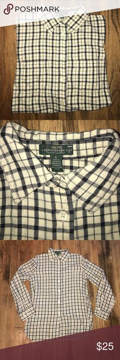 Ralph Lauren longsleeved button up polo Ralph Lauren Long sleeve button up polo black and white supersoft not stiff. Please keep in mind that I do live with a smoker. However, I do my best to keep my items out of harms way. Ralph Lauren Shirts Casual Button Down Shirts