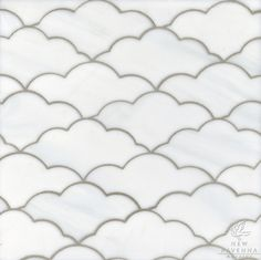 Clouds, a waterjet glass mosaic shown in Moonstone, is part of the Erin Adams Collection for New Ravenna Mosaics.