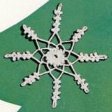 This crochet snowflake is simple to crochet and makes a great ornament to hang from your tree.