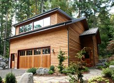 Garage with living space -- by Coates Design, Inc.